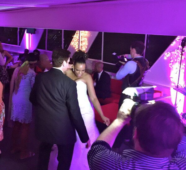 Groom and Bride dancing on affinity yacht