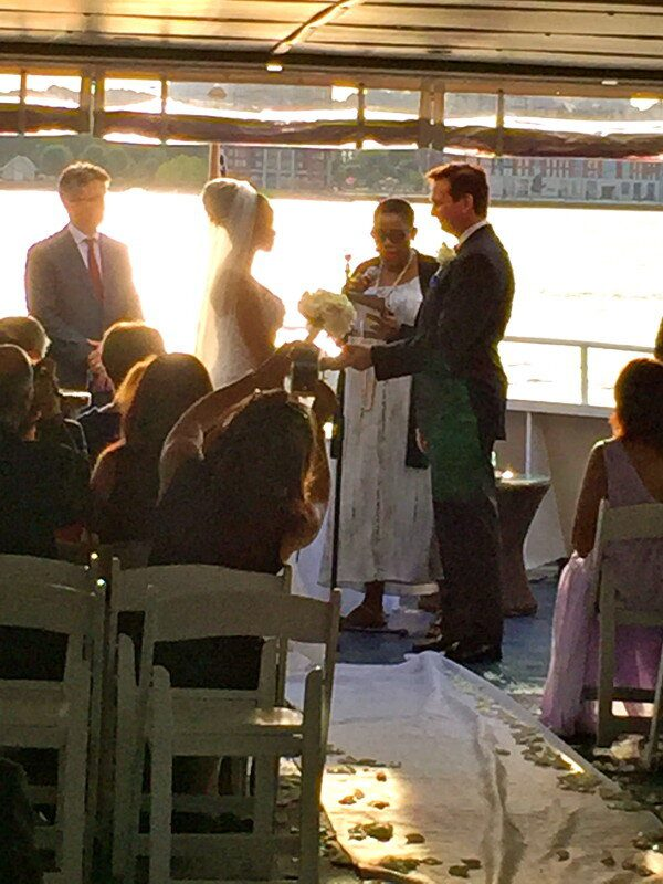 Bride and groom getting married on Yacht