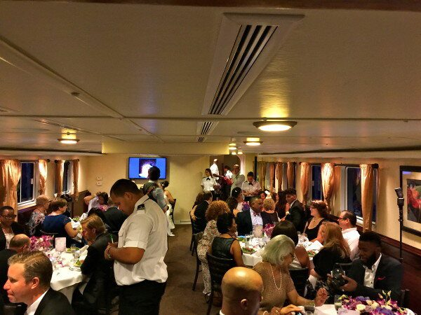 wedding guests having dinner on affinity Yacht